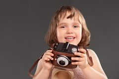 Little girl with a old camera Royalty Free Stock Images