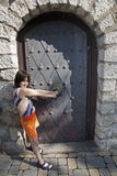 Little girl and old door Stock Image