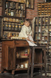 Little girl on the old kitchen Stock Photography