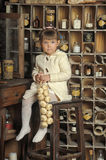 Little girl on the old kitchen Royalty Free Stock Photography