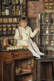Little girl on the old kitchen Stock Photos