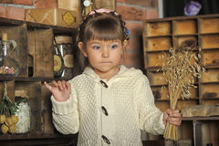 Little girl on the old kitchen Stock Photo
