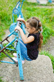 Little girl on old metal simulator Royalty Free Stock Photo