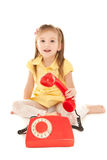 Little girl with old red phone Stock Photo
