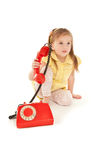 Little girl with old red phone Royalty Free Stock Photography