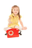 Little girl with old red phone Royalty Free Stock Photo
