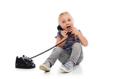 Little girl with old retro phone. Stock Images