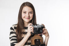 Little girl with photocamera Stock Photos