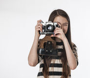 Little girl with photocamera Stock Image