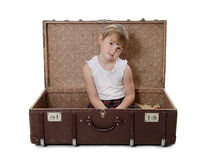 The little girl in an old suitcase  Stock Images