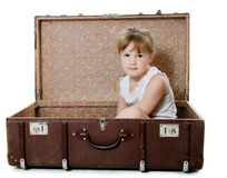 The little girl in an old suitcase isolated Royalty Free Stock Image