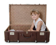 The little girl in old suitcase Royalty Free Stock Photos