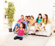 Little girl and older kids Royalty Free Stock Photography