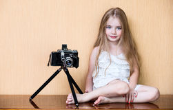 Little girl with oldest camera.  Royalty Free Stock Images