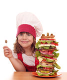 Little girl with olive and tall sandwich Royalty Free Stock Photography