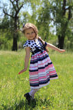 Little Girl On Grass. Royalty Free Stock Image