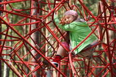 Free Little Girl On Jungle Gym Ropes Stock Image - 14708881