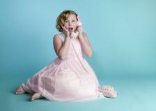 Little Girl On Pink Phone Stock Photos
