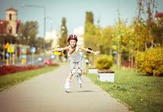 Little Girl On Roller Skates Royalty Free Stock Images