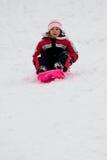 Little Girl On Sledge Stock Image