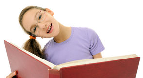 Little girl with open book Royalty Free Stock Images