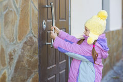 Little girl open door Stock Images