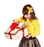 Little girl open gift box.