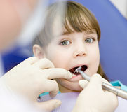 Little girl with open mouth during drilling treatment at the den Royalty Free Stock Photography