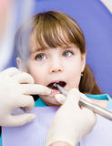 Little girl with open mouth during drilling treatm Stock Photos