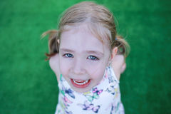Little girl with an open mouth Stock Photos