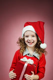 Little girl open red gift box Stock Photos
