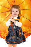 Little girl and open umbrella Royalty Free Stock Images