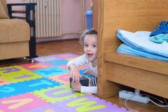Little Girl Opening A Surprise Box In Her Room Stock Images