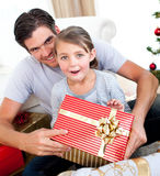 Little girl opening a Christmas present Royalty Free Stock Photo