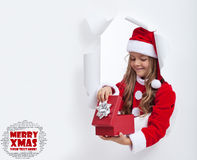 Little girl opening christmas present Royalty Free Stock Images
