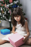 Little girl opening christmas present Royalty Free Stock Photo