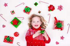 Little girl opening Christmas presents Royalty Free Stock Image