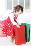 Little girl opening Christmas presents Royalty Free Stock Photography