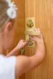 Little girl opening door. Stock Photos