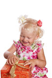 Little girl opening gift box Stock Photo