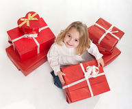 Little girl opening her presents Royalty Free Stock Images