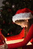 Little girl opening a magical christmas gift Royalty Free Stock Photography