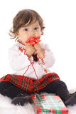 Little girl opening a present Royalty Free Stock Photos
