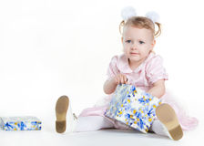 Little girl opening the present Royalty Free Stock Photography