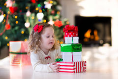 Little girl opening presents on Christmas morning Royalty Free Stock Photography
