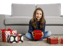 Little girl opening presents Royalty Free Stock Image