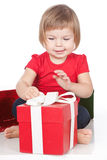 Little girl opening the red gift Royalty Free Stock Images