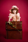 Little girl opening a wooden treasure trunk Stock Photography