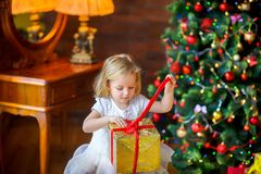 Little girl opens a gift stock photo