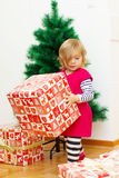 Little Girl Opens the Gift Royalty Free Stock Photo